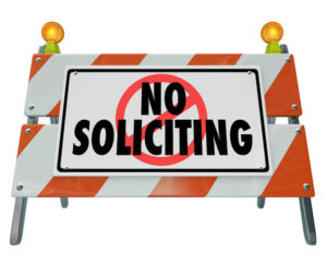 37408096 - no soliciting words on a barrier, blockade or sign to illustrate blocking annoying salespeople from selling to and annoying you
